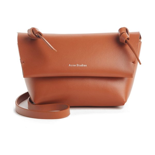 Acne Studios mini crossbody bag in cognac brown - Sized-down and streamlined, this logo-stamped shoulder...