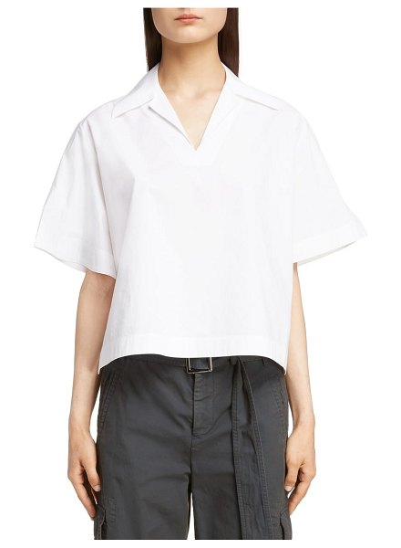 Acne Studios sasha poplin blouse in white - A boxy, structured cut makes this airy blouse-cut from...
