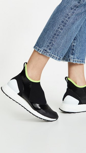 adidas by Stella McCartney ultraboost x atr sneakers in black/white/solar - Fabric: Soft knit Boost foam padding Athletic style Flat...