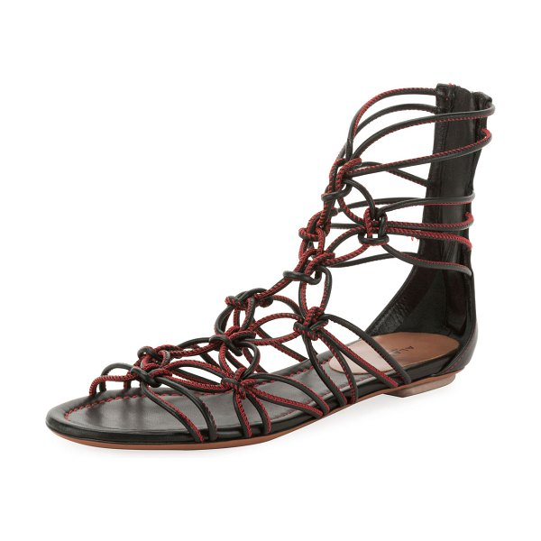 ALAIA Elegant Cord Flat Sandals in black/red - ALAÏA sandal in twisted, knotted leather cords with...