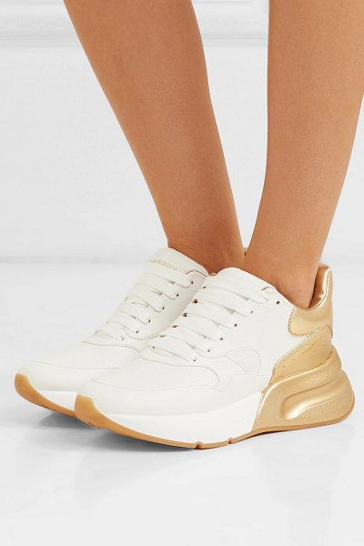 Alexander McQueen metallic-trimmed leather exaggerated-sole sneakers in gold - Alexander McQueen's sneakers are trimmed with gold so...