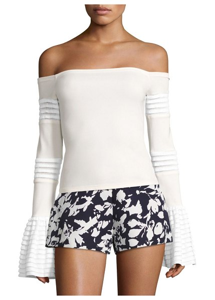 ALEXIS BARBARA Gryffin Off-The-Shoulder Bell Sleeve Top in white - Off-the-shoulder top framed by pleated bell sleeves....