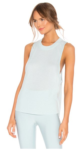 Alo Yoga Heat Wave Tank in teal - 65% poly 35% rayon. Rib knit fabric. Unfinished hem....