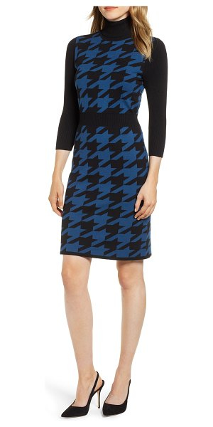 Anne Klein turtleneck houndstooth sweater dress in blue - This creatively constructed sweater-dress achieves the...