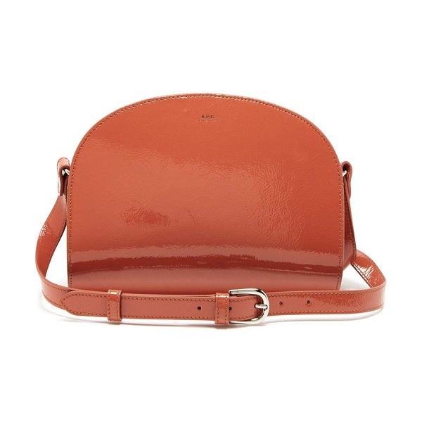 A.P.C. half moon patent leather cross body bag in orange