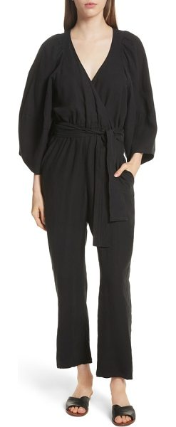 cf21ef637006 APIECE APART meru wrap front jumpsuit in black - A wrap-style front and  nipped