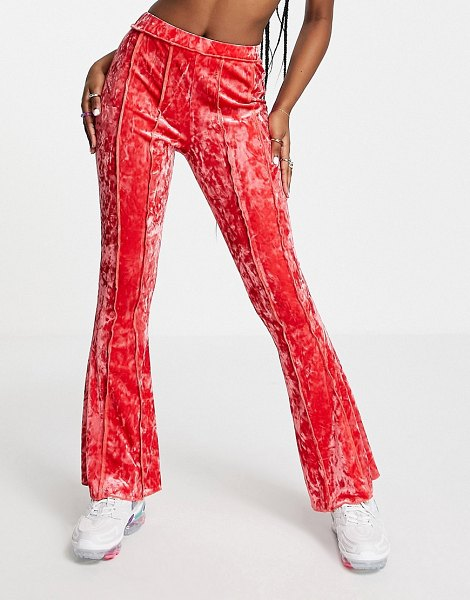 ASOS DESIGN crushed velvet flare pant with exposed seams in pink in pink