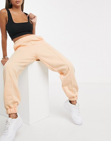 ASOS DESIGN tonal oversized sweatpants with pintuck in apricot-orange in orange
