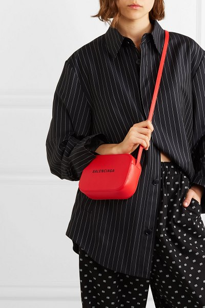 Balenciaga everyday xs aj printed textured-leather camera bag in red - Demna Gvasalia updates Balenciaga's 'Everyday' bag each...