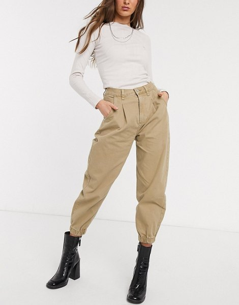 Bershka slouchy jean with cuff detail in camel-brown in brown