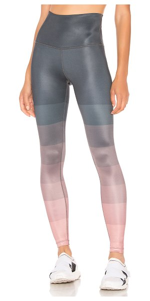 Beyond Yoga Engineered Lux High Waisted Midi Legging in pink - Poly blend. Stretch fit. Banded waist. Back screen print...