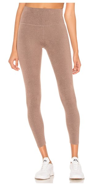 Beyond Yoga Plush High Waisted Midi Legging in pink - Nylon blend. Stretch fit. Banded waist. Made in USA....