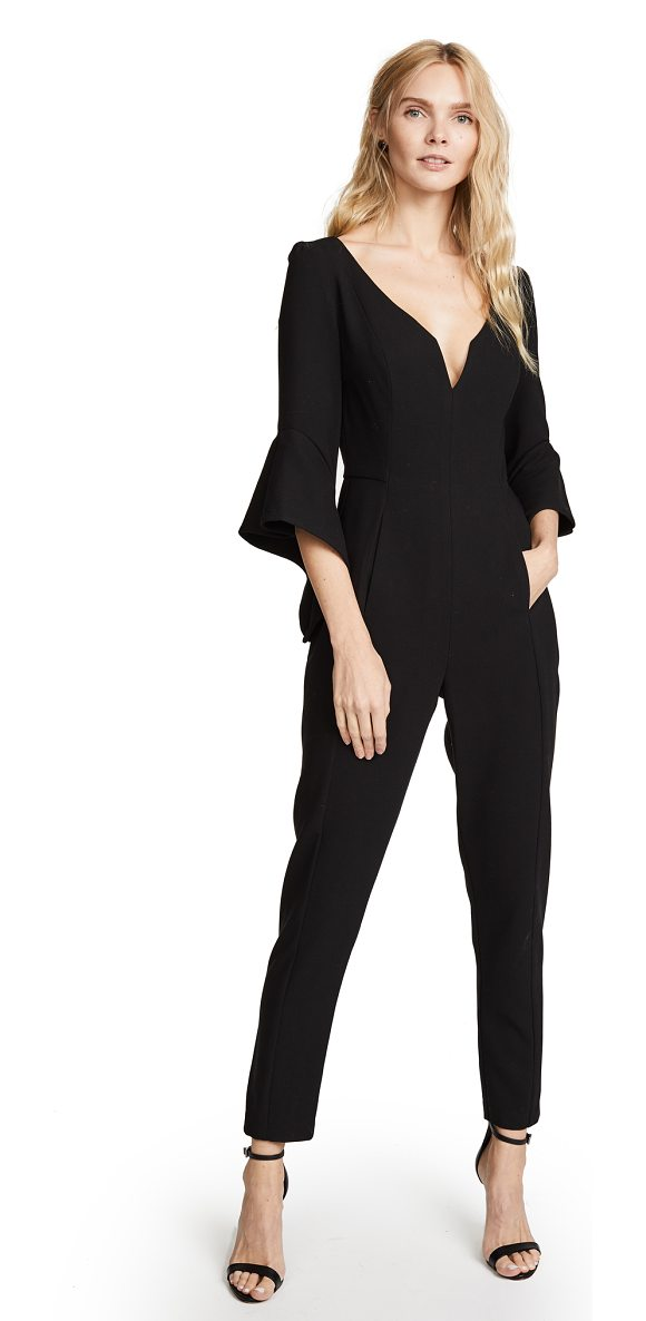 Black Halo warrior jumpsuit in black - A V-neck Black Halo jumpsuit with angled, split cuffs at...