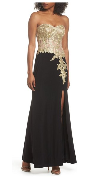 Blondie Nites applique strapless bustier gown in gold/black - Golden appliques drip down the alluring bustier bodice...