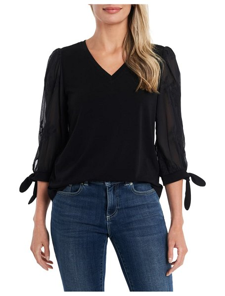 CeCe by Cynthia Steffe illusion sleeve knit top in rich black