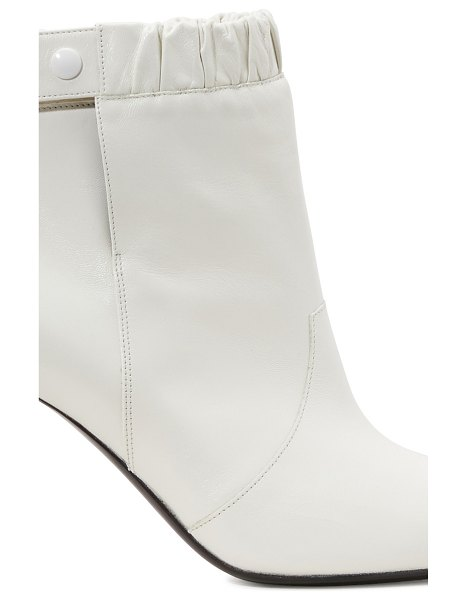 Celine Celine Triangle heel elasticated boots in 01bc
