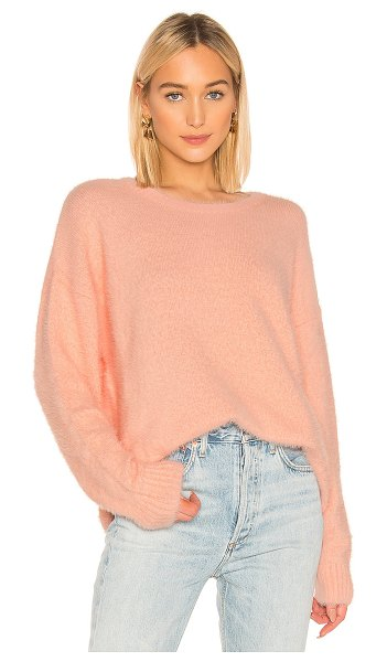 Central Park West Shangri La Sweater in pink - 100% nylon. Dry clean only. Fuzzy rib knit fabric....