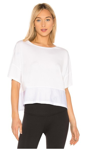 Chill by Will Donna Top in white - 92.9% modal 7.1% spandex. Tricot mesh bottom hem....