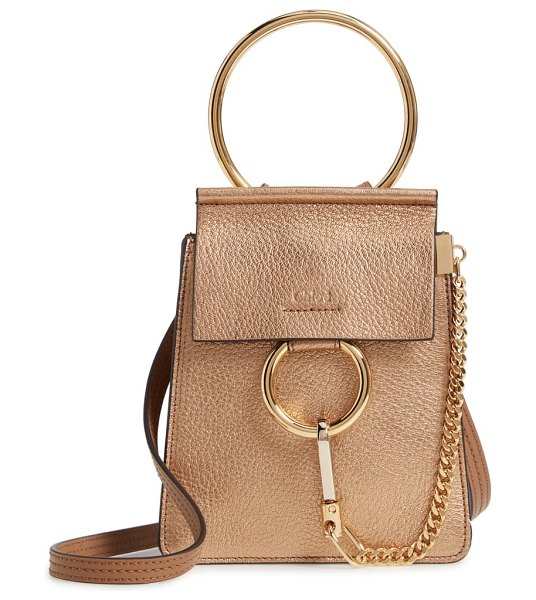 Chloe faye small metallic leather bracelet bag in metallic - Iconic equestrian-inspired hardware gleams against the...