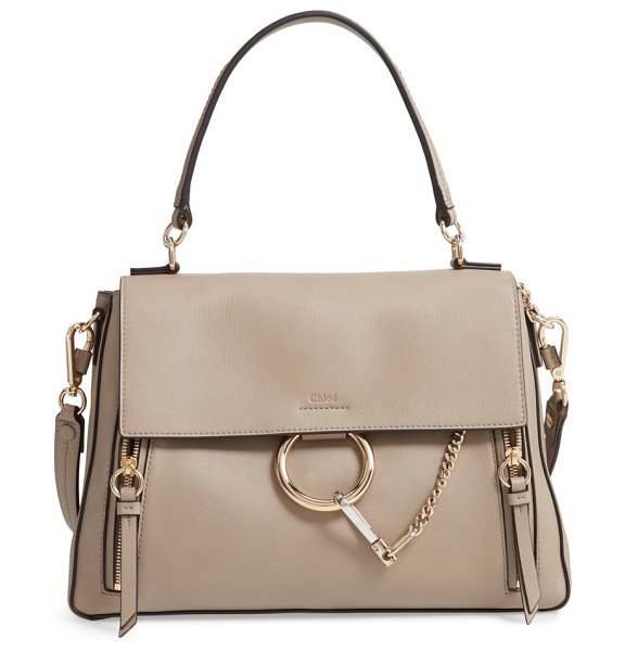 Chloe medium faye leather shoulder bag in motty grey - Iconic equestrian-inspired hardware gleams against the...