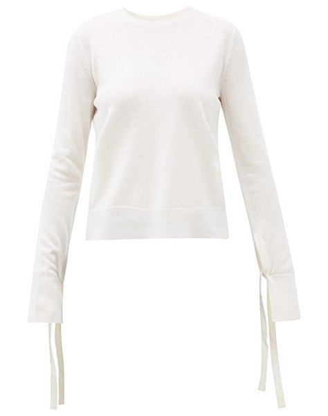 Chloe iconic slit-cuff wool-blend sweater in ivory