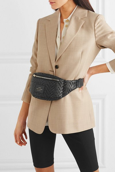 Chylak appliquéd woven faux leather belt bag in black - When designing a bag, you can't only think about its...