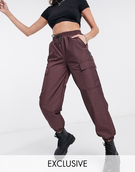 Collusion nylon sweatpants in burgundy-red in red