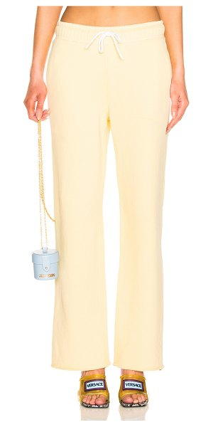 Cotton Citizen Brooklyn Sweatpant in yellow - 100% cotton.  Made in USA.  Machine wash.  Drawstring...