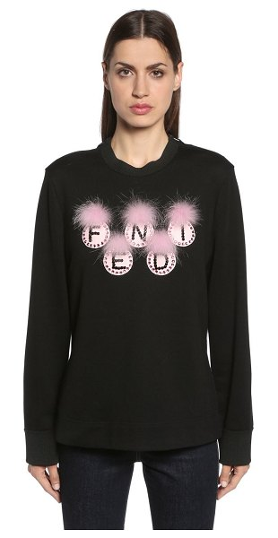 Fendi Embellished fendi logo sweatshirt in black - Crewneck. Ribbed collar and cuffs. Patches embellished...
