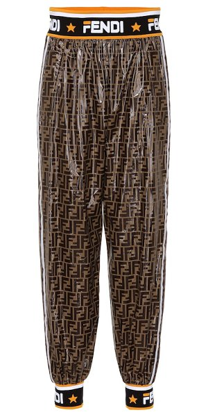 Fendi FENDI MANIA coated pants in brown - FENDI MANIA embraces the logomania trend wholeheartedly...