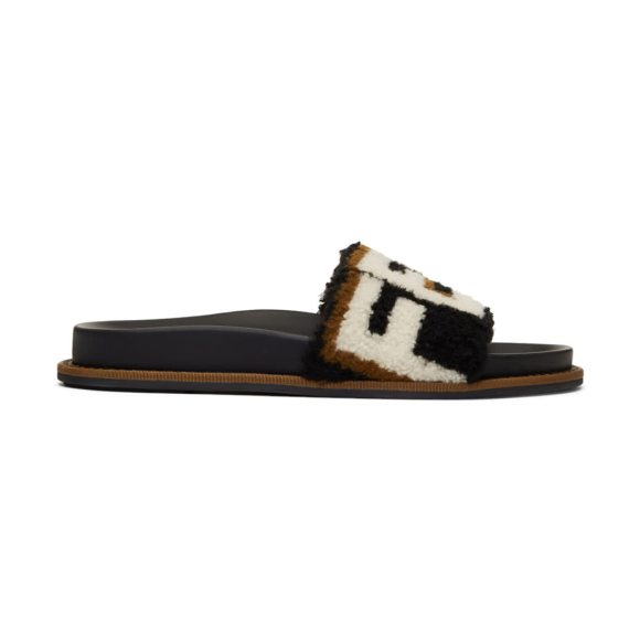 FENDI Shearling Logo Slides - Sheepskin slip-on sandals in black. Open round toe....