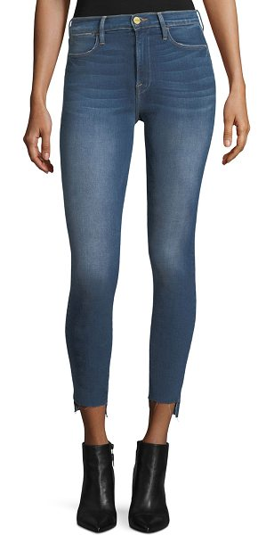 "FRAME Le High Skinny Raw-Edge Stagger-Hem Jeans in blue - FRAME ""Le High"" jeans in faded, mid-wash denim with..."