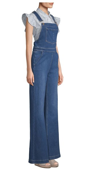 f87443ecdc5 FRAME wide-leg denim overalls in longwater - Flared denim overalls with  criss-cross