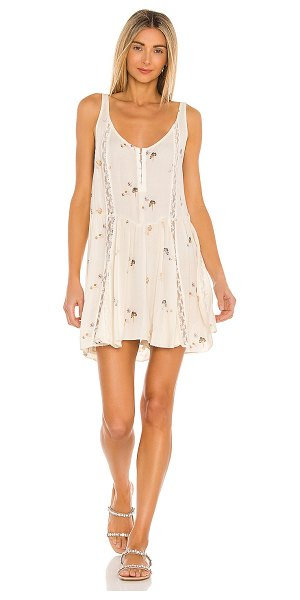 Free People give a little mini slip dress in ivory combo