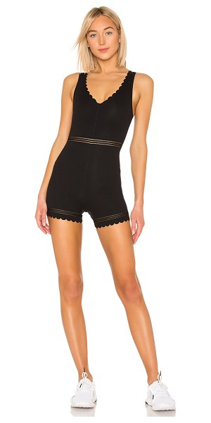 Free People Movement Genesis Bodysuit in black - Spandex blend. V-neckline. Perforated detail. Scalloped...