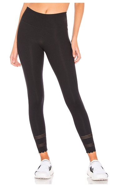 Free People Movement Genesis Legging in black - Nylon blend. Stretch fit. Hidden waist seam pocket....