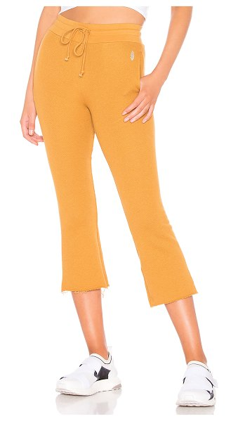 Free People Movement Reyes Sweat Pant in tan - Cotton blend. Elasticized drawstring waist. Side seam...