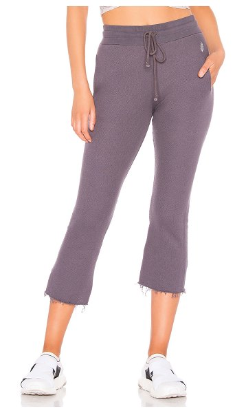 Free People Movement Reyes Sweat Pant in gray - Cotton blend. Elasticized drawstring waist. Side seam...