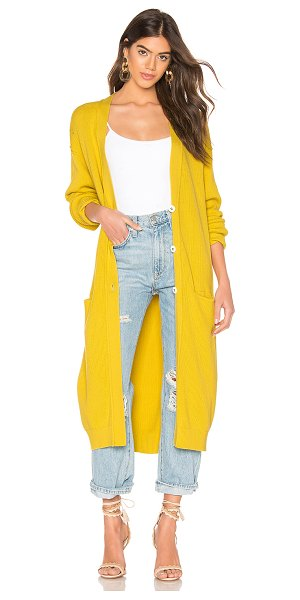 Free People Run To You Cardigan in yellow - Cotton blend. Exposed front button closure with keyhole...