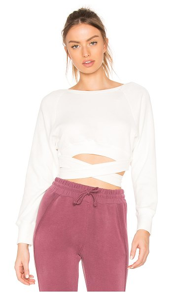FREE PEOPLE Superwoman Sweat Top - 50% poly 38% cotton 12% rayon. Ribbed trim. Wraparound...