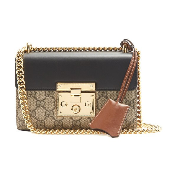 Gucci Padlock GG Supreme small cross-body bag in black - Gucci's famed beige GG Supreme print is reimagined in a...