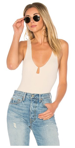 House of Harlow 1960 x REVOLVE Sawyer Bodysuit in white - 92% rayon 8% elastane. Hand wash cold. Adjustable...
