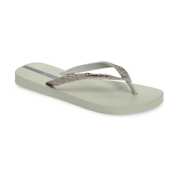 Ipanema 'glitter' flip flop in green/ green - Effusive glitter lights up the bow-bedecked straps of a...