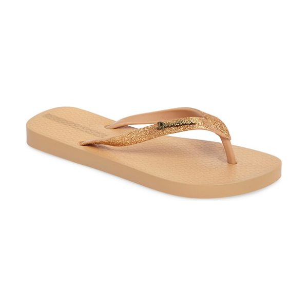Ipanema 'glitter' flip flop in beige/ gold - Effusive glitter lights up the bow-bedecked straps of a...
