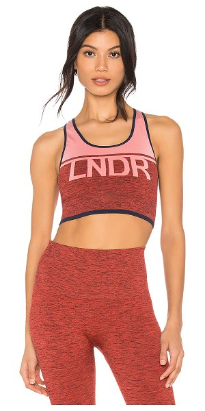LNDR A Team Sports Bra in rust - Polyamide blend. Stretch fit. Front logo graphic. Ribbed...