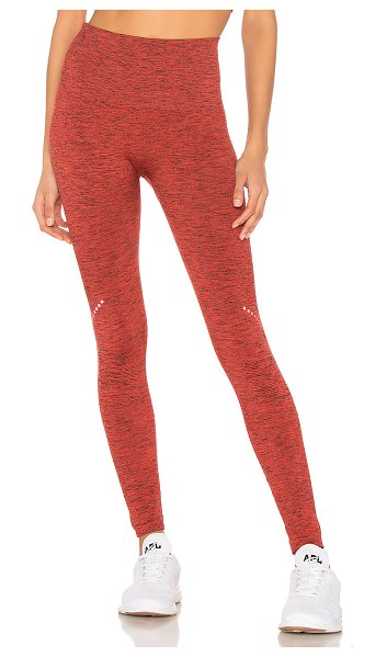 LNDR Blackout Legging in rust - Polyamide blend. Stretch fit. Marled fabric. Ribbed...