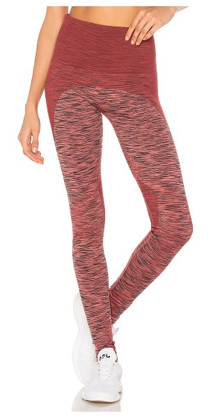 LNDR Space Legging in rust - Polyamide blend. Stretch fit. Marled fabric. Ribbed...