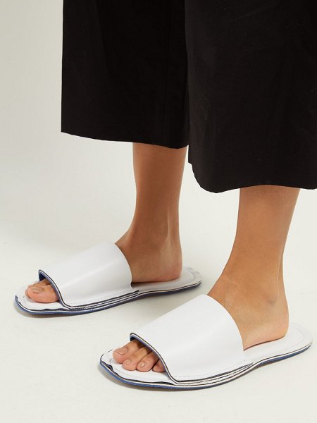 Marni raw edge leather slides in white - Marni - These white slides from Marni exemplify the...