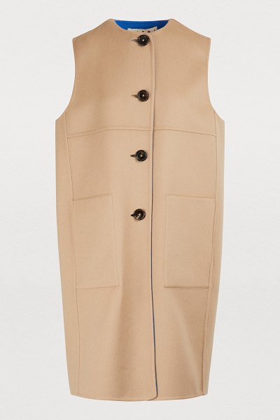 Marni Sleeveless coat in dune - The Marni collection designed by Francesco Risso is full...