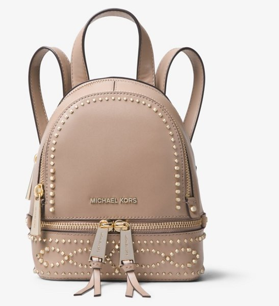 a9c7902e8c55 ... denmark michael michael kors rhea mini studded leather backpack in  brown gleaming studs punctuate our mini
